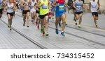 marathon running race on the...   Shutterstock . vector #734315452