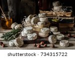 variety of french cheeses and... | Shutterstock . vector #734315722