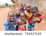 Small photo of Lugazi, Uganda. 9 June 2017. A bunch of Ugandan children laughing, smiling, waving or making funny, wacky faces and contortions.