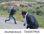 Palestinian Protester Throws A...