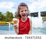 happy little boy with ice cream.... | Shutterstock . vector #734371552