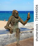 Small photo of BADALONA, SPAIN - AUGUST 23: Monkey Sculpture in Badalona, Spain on August 23, 2017. Sculpture designed by Susana Ruiz and represents the monkey bottle label brand of Anis del Mono factory.