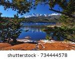 crystal reservoir after a snow... | Shutterstock . vector #734444578