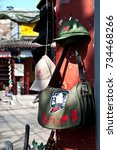 Small photo of BEIJING, CHINA - APRIL 6, 2012 - Mao bag and Communist cap souvenirs, Beijing