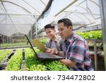 two asian male worker doing... | Shutterstock . vector #734472802
