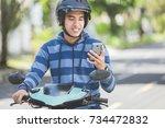 portrait of happy asian man... | Shutterstock . vector #734472832