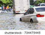 Car parking on the street and show level of water flooding in Bangkok, Thailand - stock photo