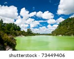 The green water of Lake Ngakoro at Wai-O-Tapu geothermal area in New Zealand - stock photo