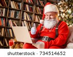 santa claus in the library... | Shutterstock . vector #734514652