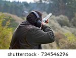 Small photo of shooter with the shotgun