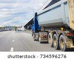 big dump truck goes in the... | Shutterstock . vector #734596276