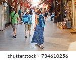 young girl tourist walking in... | Shutterstock . vector #734610256