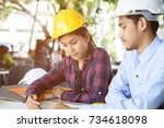 asian architect and engineer... | Shutterstock . vector #734618098