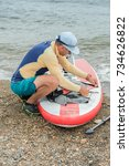 Small photo of The sport is called SUP boarding. Athlete packs up the Board after workouts