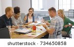 young diverse coworkers posing... | Shutterstock . vector #734650858
