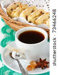 Cup of black coffee with spices and fruitcake. - stock photo