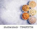 assortment of nuts and seeds ... | Shutterstock . vector #734695756