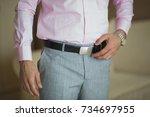 man corrects belt  close up.... | Shutterstock . vector #734697955