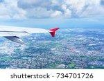 scenery from airplane 's window ... | Shutterstock . vector #734701726