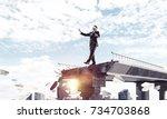businessman walking blindfolded ... | Shutterstock . vector #734703868