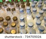 many bottles of cold milk | Shutterstock . vector #734705026