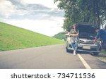 man and woman open the bonnet ... | Shutterstock . vector #734711536