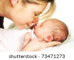 Moment of tenderness between a mother and her 18 days old baby - stock photo