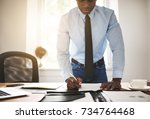 young african corporate... | Shutterstock . vector #734764468