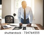 focused young african business... | Shutterstock . vector #734764555