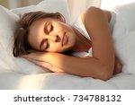 beautiful young woman sleeping... | Shutterstock . vector #734788132