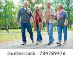 portrait of two senior couples... | Shutterstock . vector #734789476