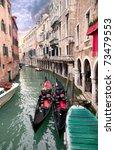Two gondola in Venice near pier at sunset - stock photo