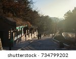 villagers are walking down hill ... | Shutterstock . vector #734799202