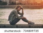 sad woman sitting at the... | Shutterstock . vector #734809735