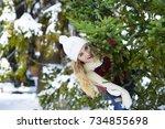 Girl Near A Christmas Tree In...