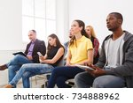 group of people sitting at... | Shutterstock . vector #734888962
