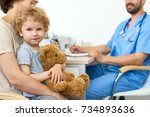 portrait of cute child sitting... | Shutterstock . vector #734893636