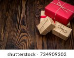 gift boxes in red and craft... | Shutterstock . vector #734909302
