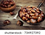 Chestnuts In A Pan On A Wooden...