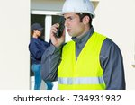 male builder in hardhat with... | Shutterstock . vector #734931982