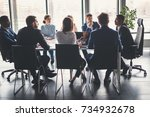 business people analyzing... | Shutterstock . vector #734932678