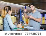 waiter making a drink for a... | Shutterstock . vector #734938795