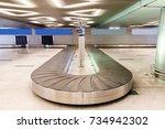 baggage conveyor belt at the... | Shutterstock . vector #734942302