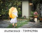 little girl in a raincoat   Shutterstock . vector #734942986