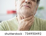 Small photo of Old man feeling painful in the throat