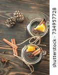 two glasses of mulled wine on... | Shutterstock . vector #734957728