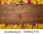 Autumn Leaves On Dark Wooden...