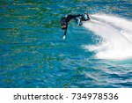 dolphin style during a flyboard ... | Shutterstock . vector #734978536