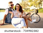 young couple in love outdoor... | Shutterstock . vector #734982382