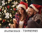 young couple on christmas eve... | Shutterstock . vector #734985985